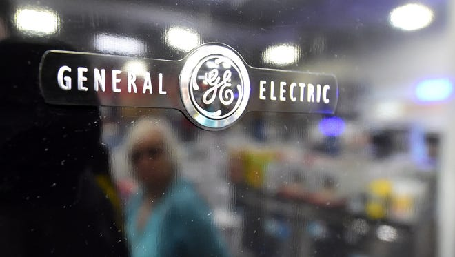 This file photo taken on January 15, 2016 shows a woman  reflected on the door of a General Electric (GE) refrigerator at a store selling electronics and appliances in Montebello, California. US industrial conglomerate General Electric said May 23, 2016 it would invest $1.4 billion in Saudi Arabia in support of the kingdom's recently unveiled plan to diversify the oil-dominated economy. Jeffrey Immelt, the GE chairman and chief executive, announced a raft of strategic partnerships and initiatives, including with state oil giant Aramco, during his visit to the kingdom.  / AFP PHOTO / FREDERIC J. BROWNFREDERIC J. BROWN/AFP/Getty Images ORIG FILE ID: 552245033