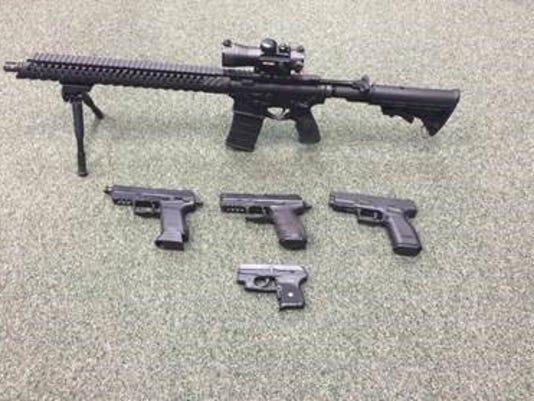 635990970758729786-handguns.jpg