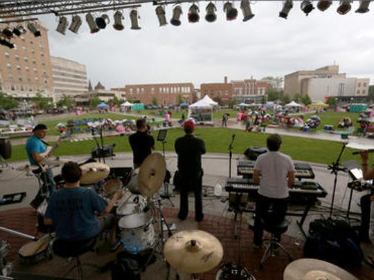 The central Wisconsin band Hip Pocket does a sound check just before Frontier Fest kicked off the summer concert season on The 400 Block in Wausau with a rainy start, Friday, May 29, 2015.