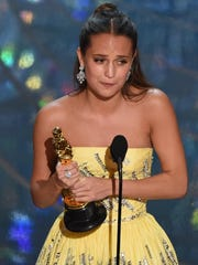 Actress Alicia Vikander accepts the award for Best
