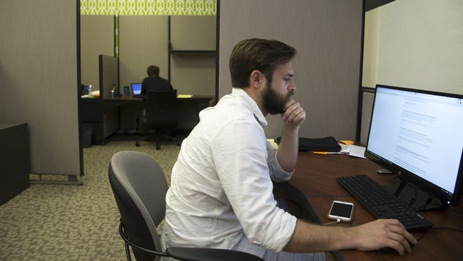 Project Manager Dylan Smart works on June 2, 2016, at his desk at MobileLogix, 5150 W. Phelps Drive, Glendale, Arizona.