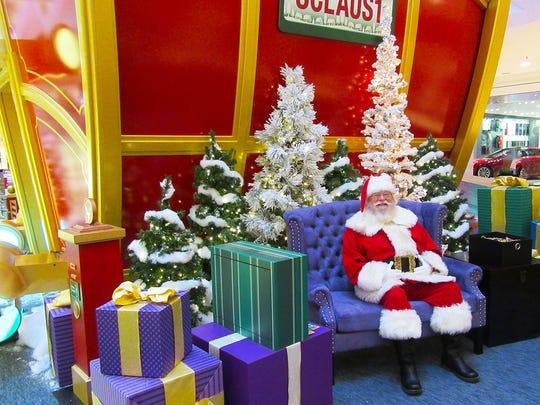 """Santa at his """"flight academy"""" set at the Mall at Short"""