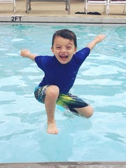 """Cade Hughes appears to add a new way of """"floating"""" as he enjoys his summer break at the Fairview Recreation Complex pool."""