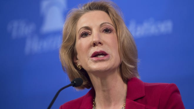 Former Hewlett Packard (HP) CEO Carly Fiorina speaks about the economy during a panel at the Heritage Foundation on December 18, 2014 in Washington, DC.