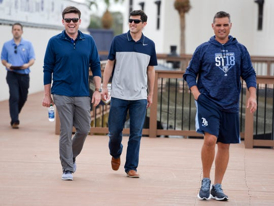 Rays GM Erik Neander, left, along with Chaim Bloom, senior vice president of baseball operations, had to sell Tampa Bay's clubhouse on sweeping changes made since camp opened.