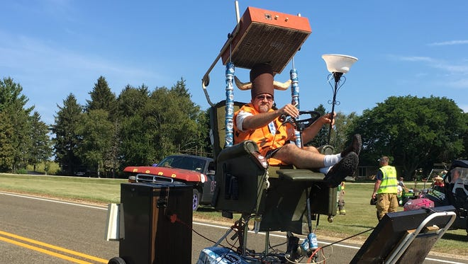 Jeff Bauman rides his junk float from Rome to Sullivan in the 2017 World's Greatest Junk Parade.
