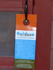 A doorknob tag alerts homeowners that their property is in the next group to receive new meters in Ruidoso.