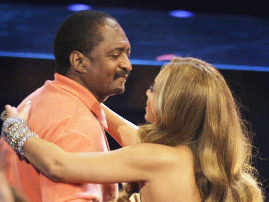 Beyoncé hugs her father, Mathew Knowles. Knowles earned a double major in economics and business administration at Fisk University.