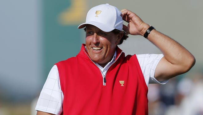 Phil Mickelson reacts to his putt on the 17th green during his foursome match at the Presidents Cup at the Jack Nicklaus Golf Club Korea in Incheon, South Korea.