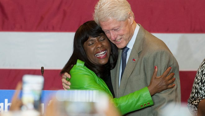 Former president Bill Clinton hugs U.S. Congresswoman Terri Sewell as he makes a campaign stop for his wife Hillary Clinton at the Alabama State University campus in Montgomery, Ala. on Saturday February 27, 2016.