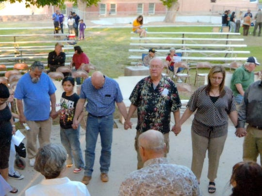Pastors of different denominations participated in a prayer circle during the 66th National Day or Prayer local event at Luna County Courthouse Park on May 4. The event drew several hundred community members to join in a prayer for business, education, church, family, media, military and government. Anne Marie Beck has helped organize the local chapter of the National Day of Prayer-Luna County.