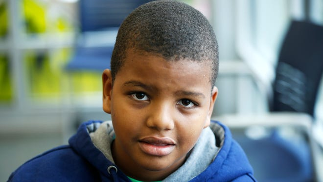 Nathaniel Joseph is a second-grader at Carson School who came to Cincinnati in October as a result of Hurricanes Irma and Maria, which devastated the US Virgin Island of St. Croix, where his family lives. The family was living without electricity and basic necessities. Nathaniel's parents made the difficult decision to send Nathaniel here to stay with his grandparents, Victor and Anna Garcia,  Photo shot Thursday, November 30, 2017.