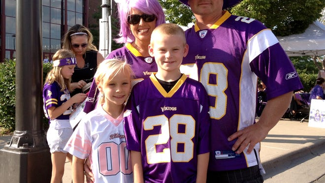 The Brophy family pose for a photo prior to the start of the Minnesota Vikings' preseason opener