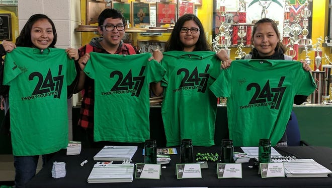 Students at Newcomb High School display T-shirts for the anti-tobacco use event called Kick Butts Day on March 14 at the high school.