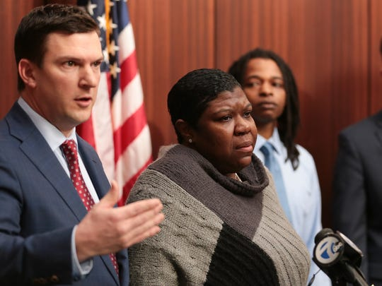 Monique Grimes speaks while standing with Attorney James Harrington at the Fieger Law Offices in Southfield on Wednesday December 20, 2017 about murder charges against a former Michigan State Police trooper, accused of firing a Taser at her 15-year-old son driving an ATV in Detroit in August.