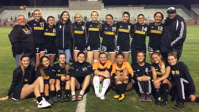 The Ventura High girls soccer team poses after becoming the first team in program history to reach a CIF-Southern Section final with a 3-1 win at La Quinta High on Tuesday night.