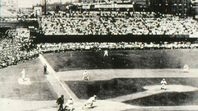 This photo is of Game One at the 1919 World Series at Cincinnati's Redland Field. The left field bleachers were temporary, just for the World Series. Also, notice the fans seated all along the inside of the left field wall.