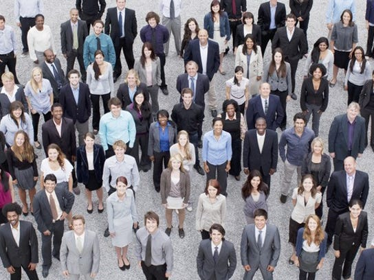 A large group of businesspeople standing, as seen from overhead.