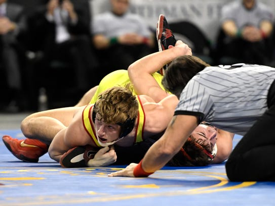 Bergen Catholic's Shane Griffith nearly pins Wall's