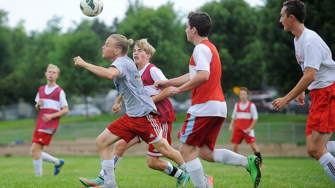 Lincoln's Theodore Savinov heads the ball during a practice Thursday, Aug. 13, 2015, at Edison Middle School in Sioux Falls.