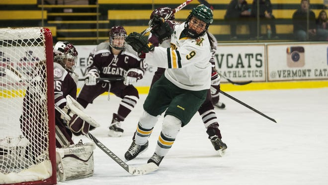Catamounts forward Dayna Colang (9) chases down the puck during the women's hockey game last season.