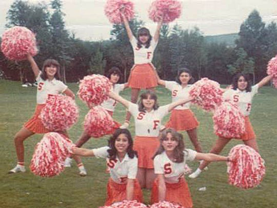 Marcela Gomez, top center, was the captain of the cheerleading