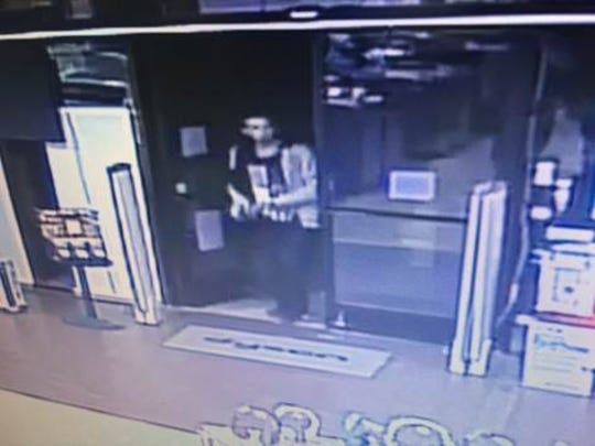 Surveillance photo of the Electronic Express theft