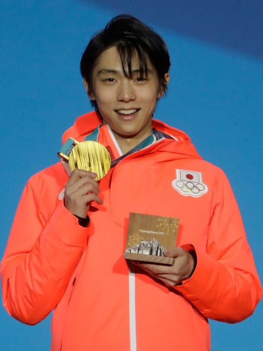 Gold medalist in men's free figure skating Yuzuru Hanyu, of Japan, smiles during the medals ceremony at the 2018 Winter Olympics in Pyeongchang, South Korea, Saturday, Feb. 17, 2018. (AP Photo/Morry Gash)