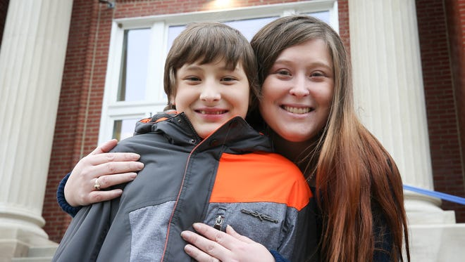 de Paul School student Marcus Martin with mom, Shea Shaw.  Shaw hopes that changes to tax law will make it easier for him to remain at de Paul.December 14, 2017