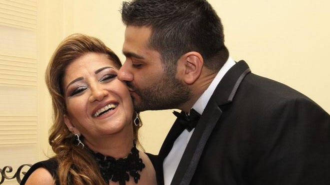 Nabih Elhajj gives his mother Zeina Chamoun a kiss in the photo from his 2015 wedding to Alaina Beaird in Beirut, Lebanon. Chamoun died the day following the Aug. 4, 2020 explosion in Beirut that killed at least 171 people and wounded thousands of others. Photo courtesy Nabih Elhajj