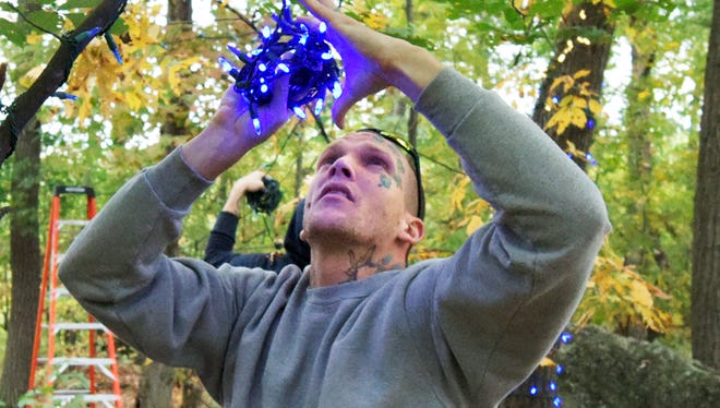 Volunteer James Mitchell of Dover Township strings LED lights along the half-mile Christmas Magic trail at Rocky Ridge County Park Wednesday, Oct. 14, 2015. This year's display boasts 600,000 lights, a new Santa scene and a computer-enabled Light-O-Rama display. Christmas Magic runs Nov. 27 - Dec. 31 from 6 p.m. to 9 p.m. weekdays and 5 p.m. to 9 p.m Saturday and Sunday. It is closed Dec. 24, 25. Bill Kalina - bkalina@yorkdispatch.com