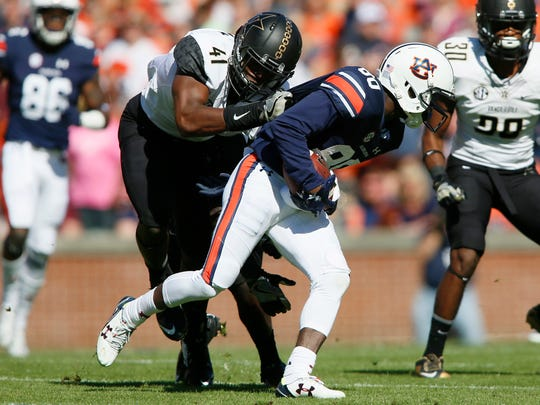 Auburn Tigers receiver Marcus Davis (80) is tackled by by Vanderbilt Commodores linebacker Zach Cunningham (41) during the first quarter on Nov. 5, 2016.