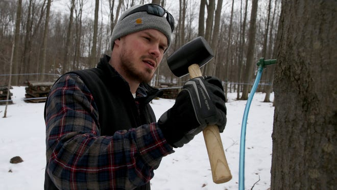 Chris Hurley hammers in a fresh tapped at Kettle Ridge Farm.