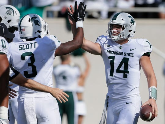 Michigan State quarterback Brian Lewerke high-fives