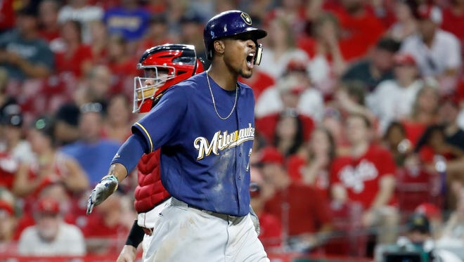 Keon Broxton of the Brewers is pumped up after hitting his second homer of the night against the Reds.