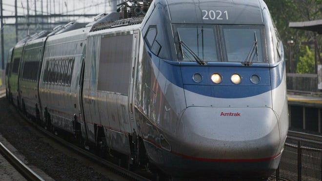 An Amtrak Acela train pulls through the New Brunswick train station on the Northeast Corridor Line.