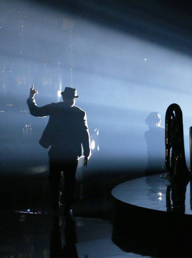 A band member walks out before Justin Timberlake performs at Talking Stick Resort Arena during the Man of the Woods Tour in Phoenix, Ariz. May 2, 2018.