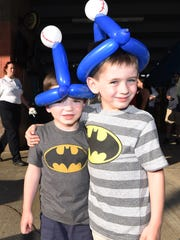 Luke Powers, 4, left, and Ben Powers, 6, right, of