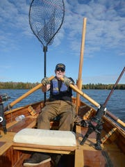 Tom Heberlein rows Patrick Durkin's cedar-strip boat