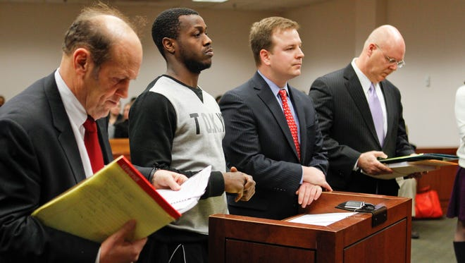Former UofL basketball player Chris Jones pleaded not guilty on charges of raping one woman and sodomizing another one. Jones was released on home incarceration in lieu of a $25,000 bond. Jones is surrounded by attorneys, from left, Rob Eggert; Ryan McCall; and attorney Scott C. Cox, at far right. Jones was dismissed from the Louisville men's basketball team Feb. 22 after violating curfew as well as being suspended from the team Feb. 17 after sending a text message to an unnamed individual. By Matt Stone, The Courier-Journal February 26, 2015