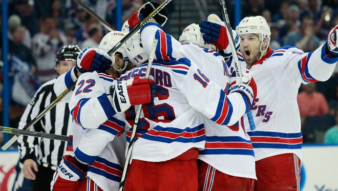 New York Rangers defenseman Dan Boyle (22) and New York Rangers center Derick Brassard (16) and New York Rangers left wing Rick Nash (61) celebrate a goal by New York Rangers center J.T. Miller (10) during the third period of game six of the Eastern Conference Final of the 2015 Stanley Cup Playoffs at Amalie Arena. Mandatory Credit: Kim Klement-USA TODAY Sports ORG XMIT: USATSI-225472 ORIG FILE ID:  20150526_mjm_sv7_078.JPG