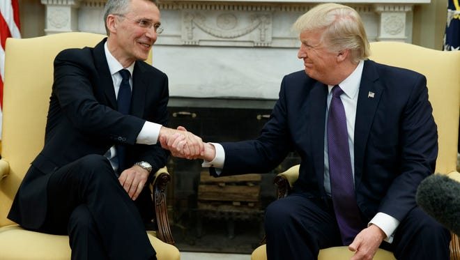 President Donald Trump shakes hands with NATO Secretary General Jens Stoltenberg in the Oval Office of the White House in Washington on Wednesday.