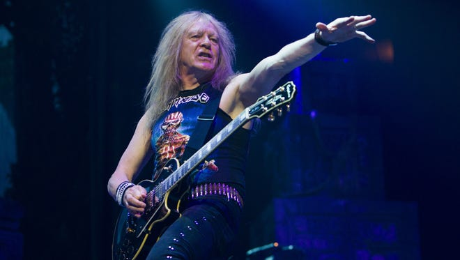 Iron Maiden guitarist Janick Gers performs during the band's The Book Of Souls World Tour stop at Talking Stick Resort Arena in Phoenix, AZ on June 28, 2017.