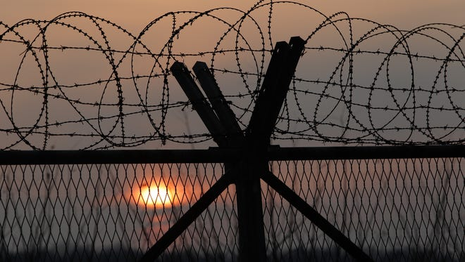A barbed wire fence at a military check point near the demilitarized zone (DMZ) separates South and North Korea on Jan. 6, 2016 in Paju, South Korea.