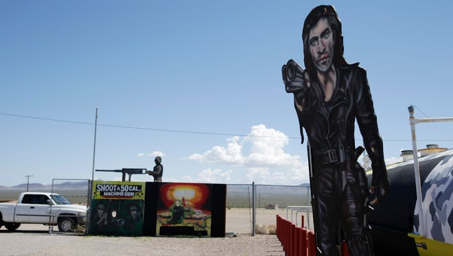 Painted signs are displayed outside the Last Stop outdoor shooting range in White Hills, Ariz.