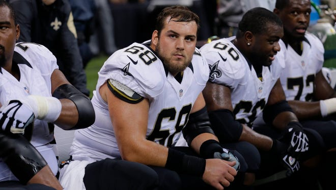 New Orleans Saints guard Tim Lelito (68) sits on the bench in the second half of an NFL football game against the Minnesota Vikings. Lelito is expected to start against Dallas on Sunday night.