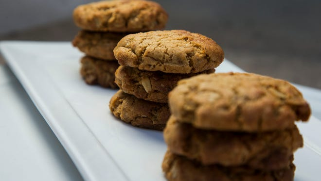 Celebrated Cuisine, Inc. owner Laura Briscoe makes Super LocoCocoNut Crunch Cookies on Tuesday, August 5, 2014.
