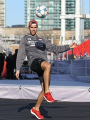 Red Wings' Ryan Sproul warms up prior to play against