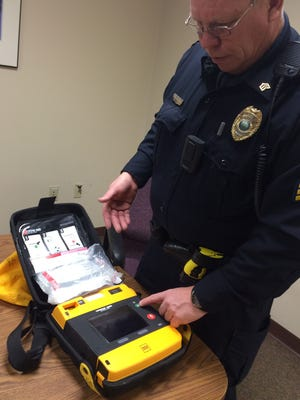 "Coralville Police Sgt. Tim Vest displays a LifePak defibrillator unit Wednesday inside the police station. Since Dec. 1, Coralville officers have responded to six cardiac emergencies and made five successful ""saves"" using mobile defibrillators and CPR."