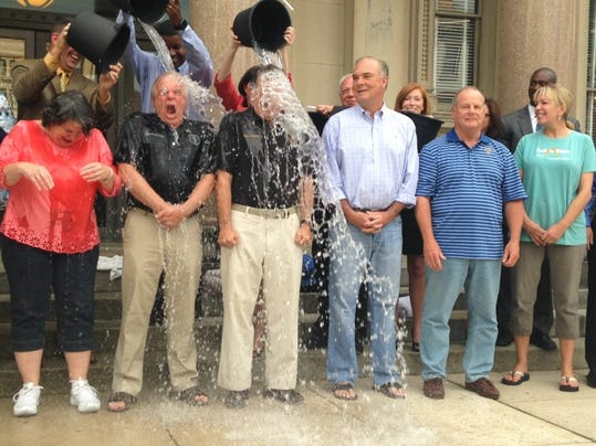 Members of Gov. Chris Christie's Cabinet take part in the ALS Ice Bucket Challenge, Aug. 20, 2014 on the steps of the Statehouse in Trenton, N.J. (Michael Symons/Asbury Park Press)